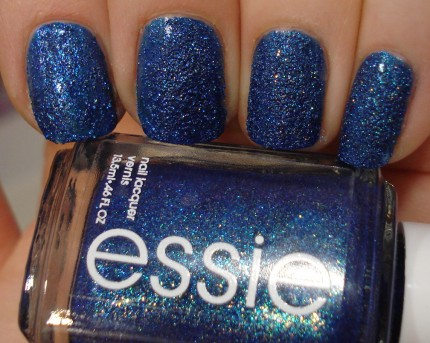 Essie lots of lux blue sandy nail polish close up macro photo